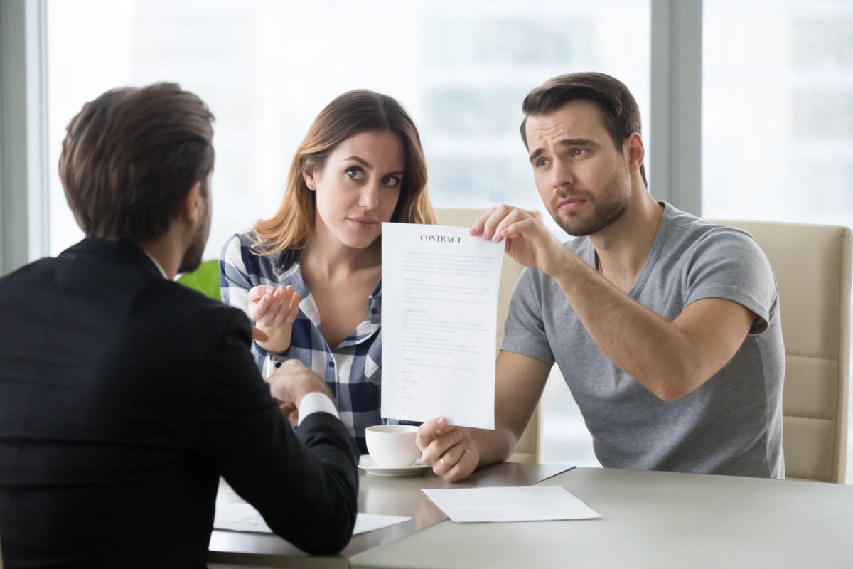 Young couple is dissatisfied with terms of contract